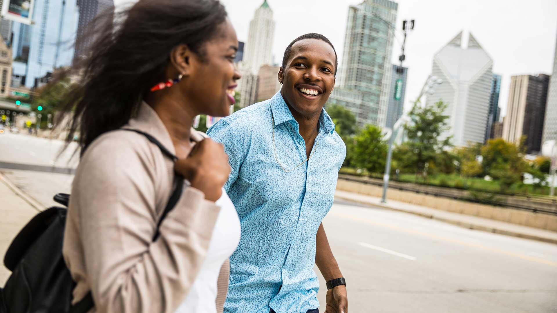 A couple walks down a street in the South Loop neighborhood of Chicago.