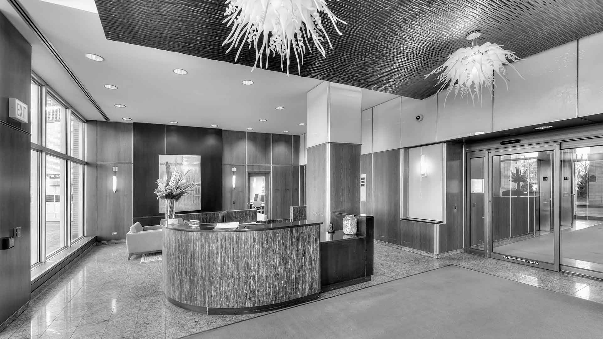 The lobby at Eleven Thirty. The front desk is in the center and a guest waiting area is behind it. The doors to the elevator lobby are seen on the right.