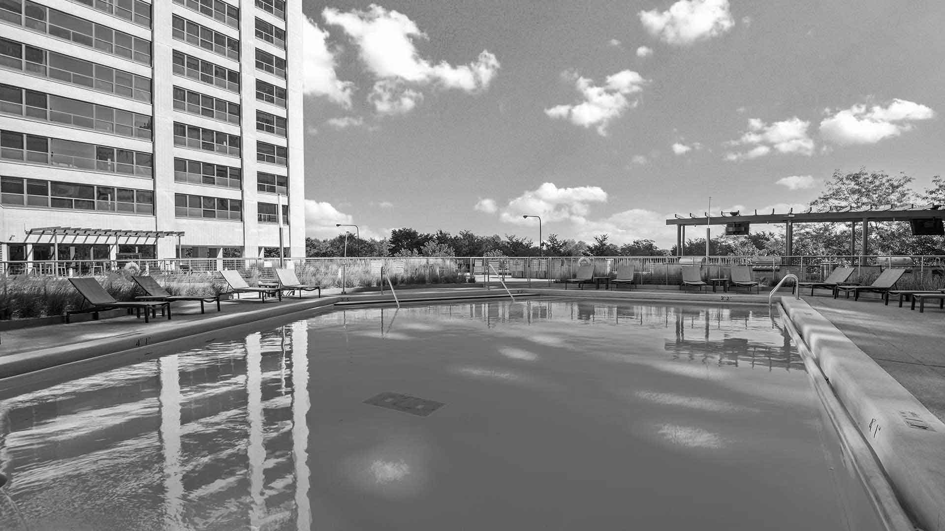 A close view of the outdoor pool and sundeck at Eleven Thirty on a sunny day.